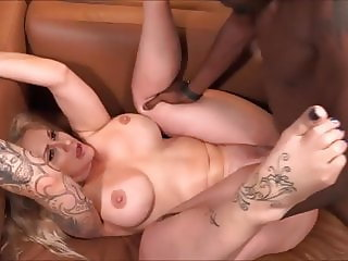 Tattooed Mature Slut Takes Young BBC In All Holes