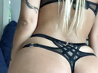 Sexy blonde plays with pussy
