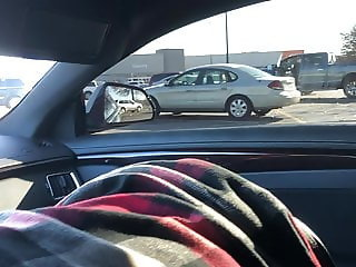 Wife sucks my cock in the car in a public parking lot.