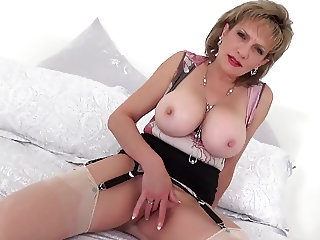Lady Sonia playing with her big tits and fingering