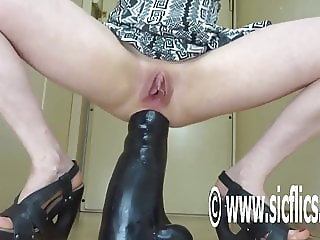 Destroying her ass with a gigantic dildo