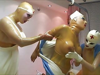 Latex slave in dungeon