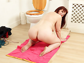 British milf Beau Diamonds gets busy on bathroom floor