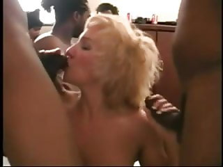 Pretty blonde enjoys a IR gangbang