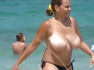 Shameless MILF with Big Boobs with No Bra on the Beach