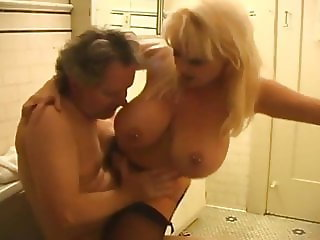 mature couple, she cleans his cum with mouth (big tits)