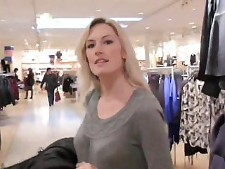 two crazy milf using strapon in public fitting room