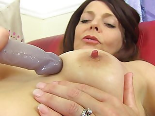 Mature mother feeding soaking pussy