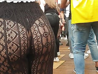 Girls dancing in see through fishnet pants at festival