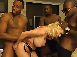 Cougar gets fucked by a group of big black dicks