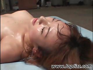 Busty Asian girl gets covered in cum and gets peed on as well