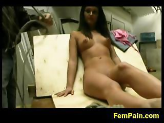 Cute brunette tied up for whipping
