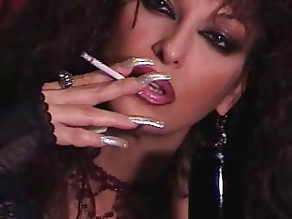 Mature Brunette teasing in pantyhose, long nails, smoking