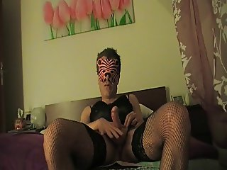 tiger masked crossdresser with toys