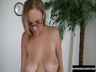 Blonde girl with glassesand huge tits gives a blowjob