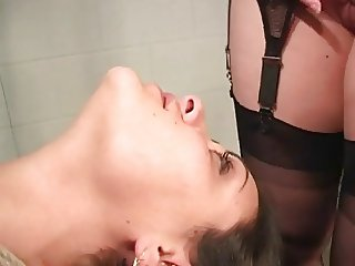 Lesbian BDSM Woman in bondage facesitting