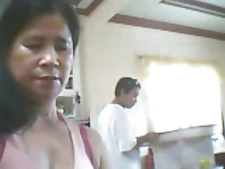 Filipino woman want show her tits but son beside her