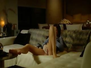 Amazing brunett rubbing pussy on a sofa
