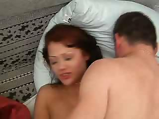 Red-head cutie is put on the bed and fuck to half-consciousness