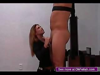 Tied guy is rubbing the head of his big cock against female`s playful lips