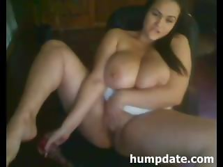 Busty brunette with lactating tits shows them and her pussy off