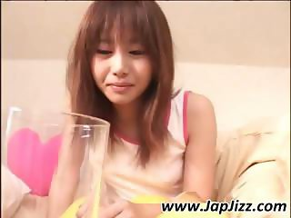 Japanese girl with hairy snatch pees into a glass and then has a drink
