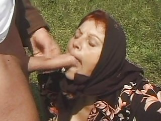 Redhead granny fucking in the fields
