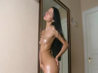 Oiled sweety masturbating both vaginas