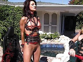 Brunette femdom slave used as a riding horse