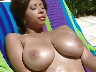 Busty girl sunbathing