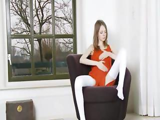Skinny pussy undress on the armchair