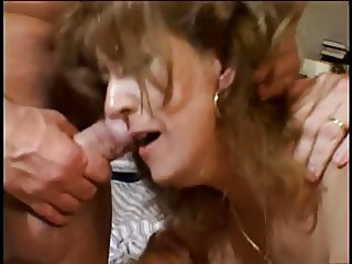 Horny married brunette sucks on three hard cocks at once then gets drilled