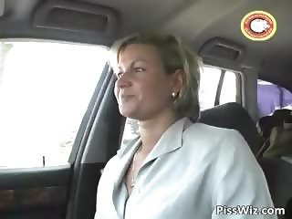 Mature blonde slut pisses outside part2