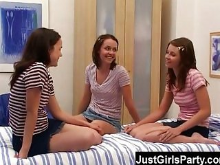 Three brunette teens playing with dildos