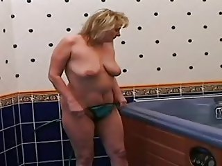 fat mature is sucking and fucking in the Jacuzzi