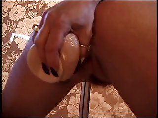 Busty blonde strips and fucks huge dildo at home