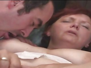 Redhead mature with big tits fuck on the sofa