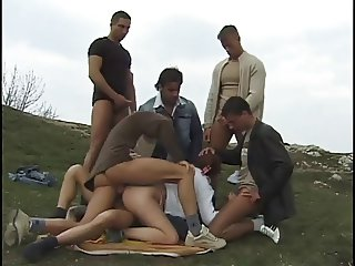 Teen gangbanged in the mountains by a pride of dirty men