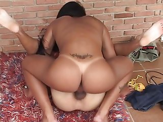 Sexy tgirl stuffs a big cock in her mouth and sucks on it deep then fucks