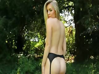 outdoor busty blond making strip