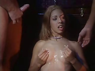 Porn actress gets her hands filled with cum from buff guys