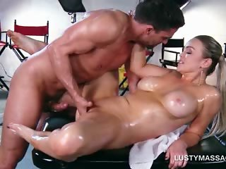 Lustful masseur nailing oily shaved pussy on his table