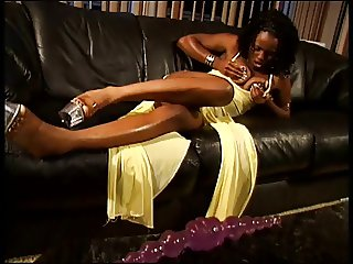 Ebony goddess with piercings fucks her pussy and ass with pink dildo indoors