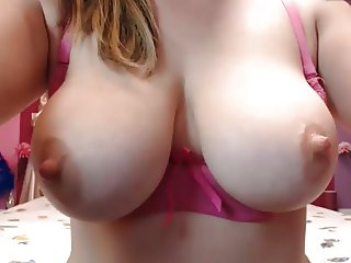 Busty MILF with big boobs and hard nipples plays on web cam
