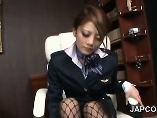 Asian office babe in fishnets giving footjob at work
