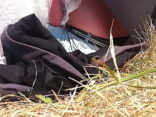 Young woman showing black thong at air show