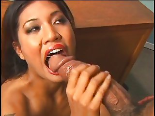 Gorgeous Asian whore wraps her lips around a super-thick cock then fucks