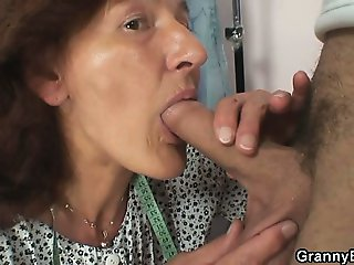 Sewing granny takes his cock