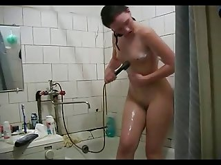 Hot girl having fun in the shower
