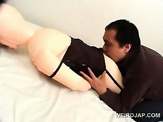 Dirty asian guy dripping wax on his plastic sex dolls cunt